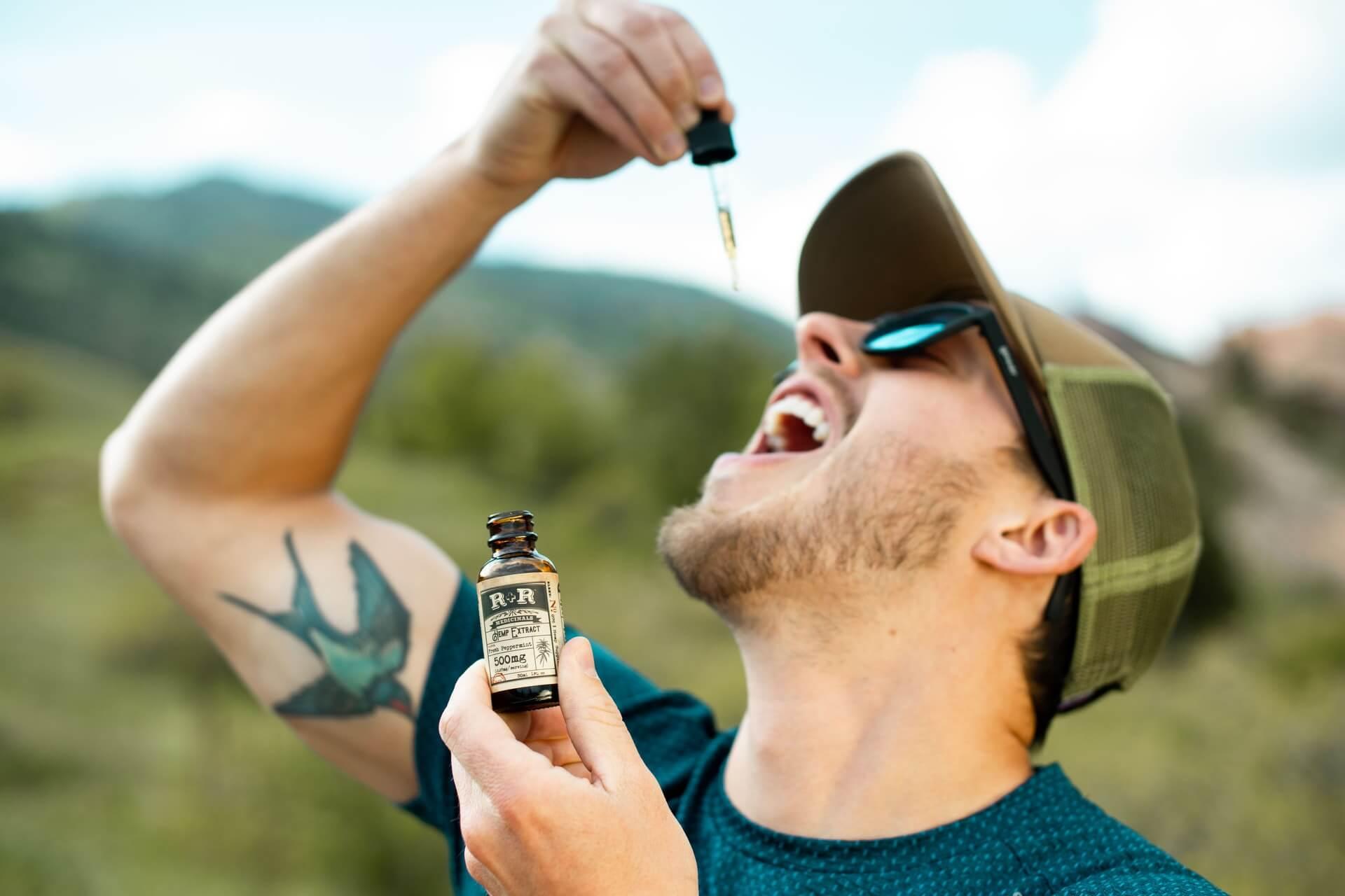 man tasting cbd oil