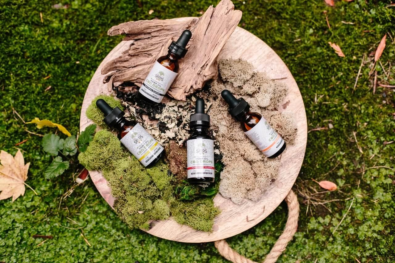 cbd oil on green moss